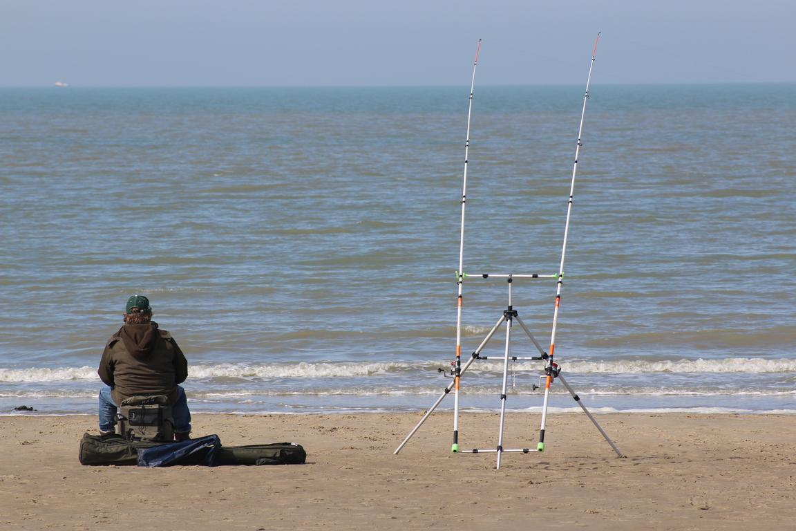 Angler am Cadzand-Bad-Strand